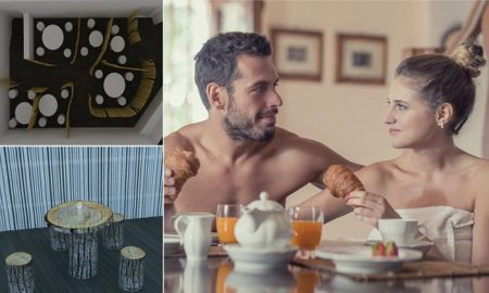 Young undressed couple have breakfast in the morning